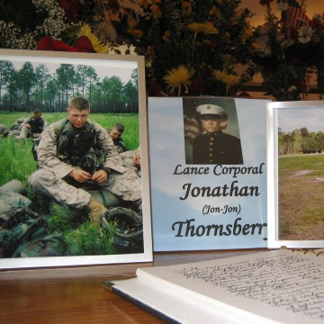 Image: Photos of Marine Lance Cpl. Jonathan Thornsberry at his funeral in 2006.
