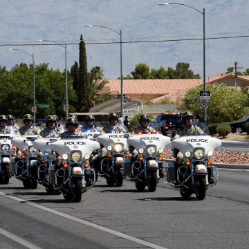 Image: A procession of police officers arrives at the funeral for Las Vegas Metropolitan Police Department Officer Igor Soldo at Canyon Ridge Christian Church