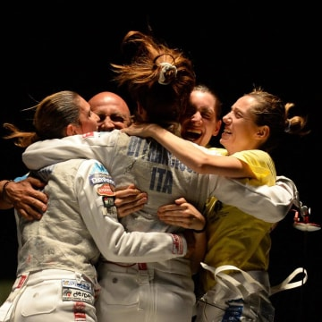 Image: The Italian team celebrates after beating Russia in the final of the women's team foil competition at the European Fencing Championships
