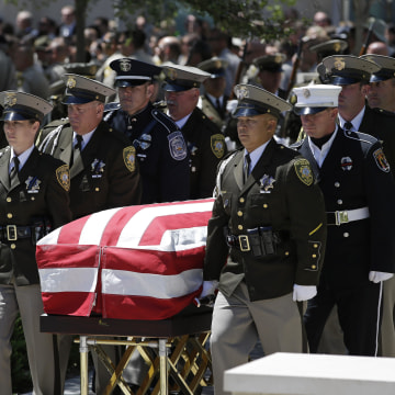 Image: Second Funeral Held For Police Officers Shot By Extremist Couple