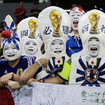 Image: Japanese supporters react before the start of  the group C World Cup soccer match between Ivory Coast and Japan at the Arena Pernambuco in Recife, Brazil