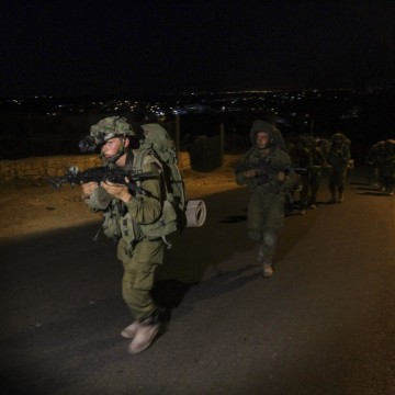 Image: Israeli soldiers patrol during the search Sunday for three missing teenagers