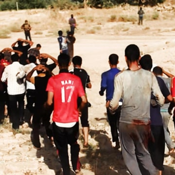 Image: ISIS militants purportedly lead captured Iraqi soldiers to an open field moments before shooting them