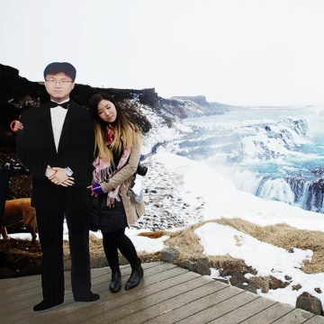 Jinna Yang says she traveled the world with a cardboard cutout of her late father.