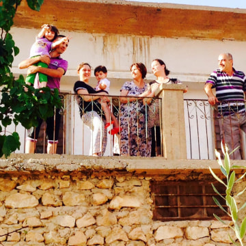 Image: Leith Rahima and his family stand in Al-Qosh, an Assyrian Christian town in northern Iraq.