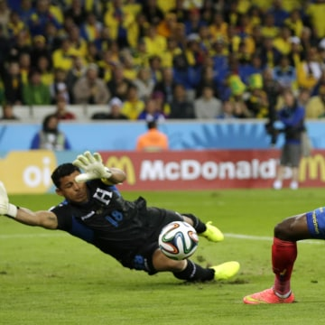 Image: Honduras' goalkeeper Noel Valladares, left, can't stop Ecuador's Enner Valencia shot as he scores his side's first goal during the Group E World Cup soccer match