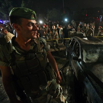 Image: Lebanese army and citizens gather at the site of a car bombing in a southern suburb of Beirut