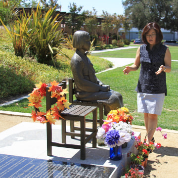 Phyllis Kim of the Korean American Forum of California explains each part of the Comfort Women Statue memorial on June 22, 2014  in Glendale, California.
