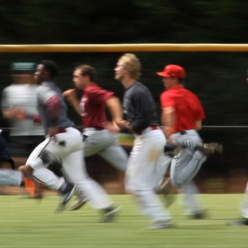 Image: A batch of outfielders run the 60 yards dash.