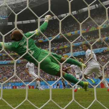 Image: Germany's Mueller scores past Howard of the U.S. during their 2014 World Cup Group G soccer match in Recife
