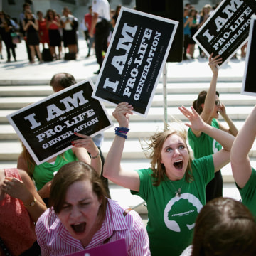 Image: Anti-abortion advocates cheer in front of the Supreme Court after the decision in Burwell v. Hobby Lobby Stores was announced
