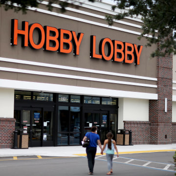 Image: People walk to a Hobby Lobby store in Plantation, Fla.