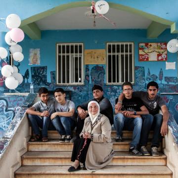 Image: Headmistress Hazar Mahayni sits on the steps of the Al Salam school in Reyhanli, Turkey.