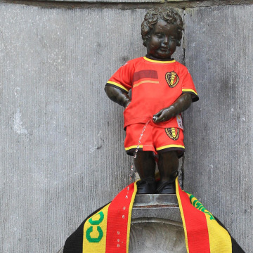 Image: A tourist takes a snapshot of Brussels iconic statue 'Manneken Pis'