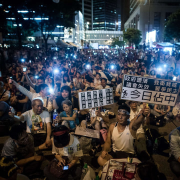 Image: Demonstrators stage a sit-in overnight July 1 in Hong Kong