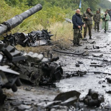 Image: Ukrainian troops stand near destroyed military vehicles just outside Slaviansk