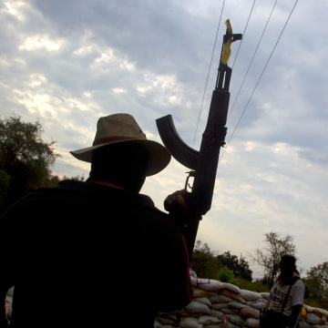 Image: Armed members of the citizens' self-protection police in Mexico's Michoacan State