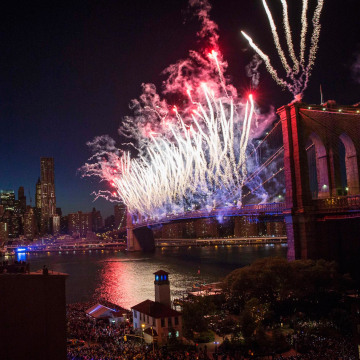 "Image: Fireworks explode over Brooklyn Bridge and East River during ""Macy's Fourth of July Fireworks Spectacular"" in Brooklyn borough of New York"