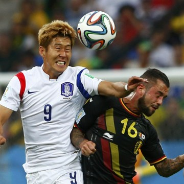 Image: South Korea's Heung-min and Belgium's Defour fight for the ball during their 2014 World Cup Group H soccer match at the Corinthians arena in Sao Paulo