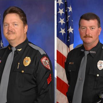 Image: A city official says two police officers in Florida, David Borst and George Hunnewell, are no longer with the department after a law enforcement report tied them to the Ku Klux Klan.
