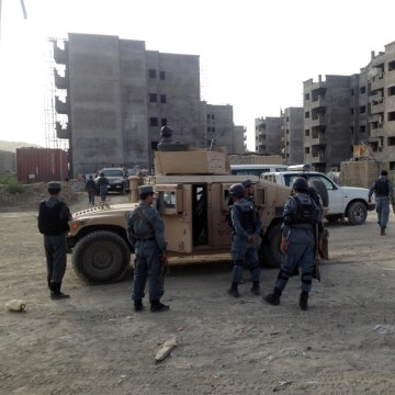 Image: Afghan Police secure the surroundings of Kabul International Airport during a gun battle with suspected militants