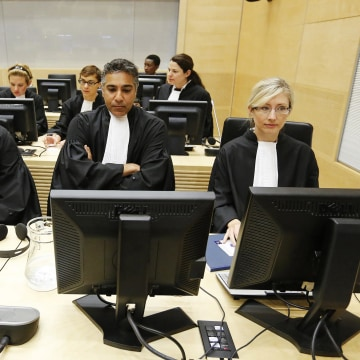 Image: Prosecutor Fatou Bensouda, left, awaits the sentence of Congolese warlord Thomas Lubanga in the courtroom of the International Criminal Court (ICC) in The Hague, Netherlands, on July 10, 2012.
