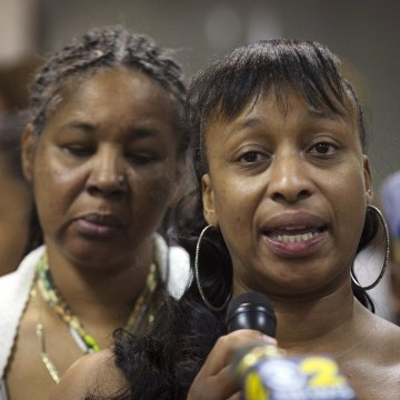 Image: Ellisha Flagg, sister of Eric Garner, speaks beside his wife Esaw Garner, left, during a service at the Mount Sinai Center for Community Enrichment for Eric Garner