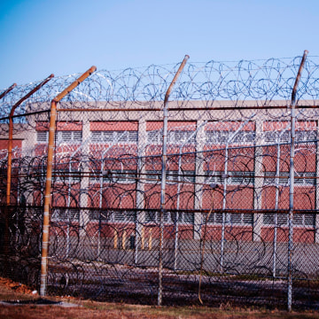 Barbed wire fences surround a building on Rikers Island Correctional Facility in New York