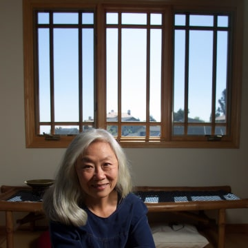 Image: Author Maxine Hong Kingston sits in her meditation room at home in Oakland, Calif., on April 10, 2001.