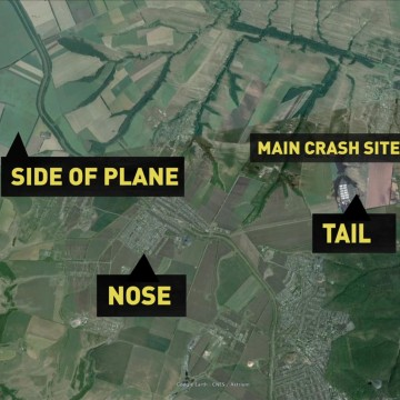 Image: A graphic shows the locations where different pieces of flight MH17 landed.