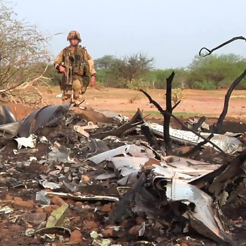 French soldiers stand by the wreckage of the Air Algerie Flight 5017 which crashed in Mali's Gossi region, west of Gao, on July 24.