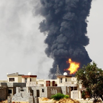 Image: Flames and smoke billow from an oil depot in Tripoli