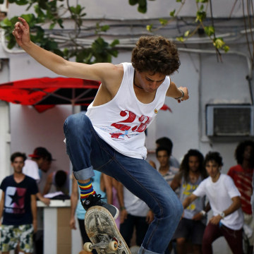 "Image: A Cuban skateboarder, part of the ""G y 23"" generation as the group is known"