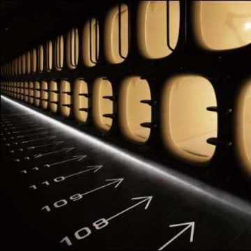 Image: Numbered sleeping pods at the nine hours capsule hotel in Tokyo's Narita Airport.