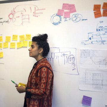 Image: Kiran Gandhi, the drummer for rapper MIA, works during a brainstorming session at Harvard Business School's Innovation Lab.
