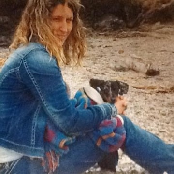 Image: Sandra Miller holds her dog on Glass Beach near Fort Bragg, Calif. in April 2013, a month before she was killed.