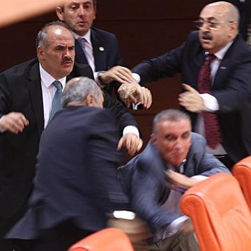 Image: Opposition MHP party deputy Ali Uzunirmak (2nd R)  fights with AKP's deputy Mustafa Sahin (2nd L)
