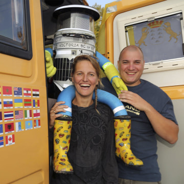 Image: HitchBOT is seen with Belgian tourists Kim Van Aerde and Seb Leeson in Sault Ste. Marie, Ontario