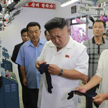 Image: North Korean leader Kim Jong-un visits a hosiery factory