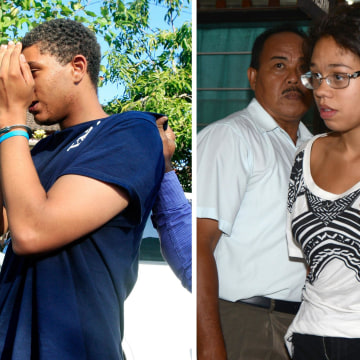 Image: Indonesian police escort Tommy Schaefer, left, and Heather Mack for questioning in relation to the death of Mack's mother on the resort island of Bali.