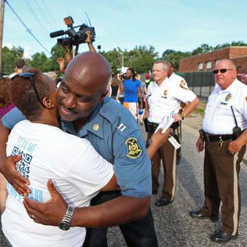 Image: Capt. Ron Johnson of the Missouri Highway Patrol hugs Angela Whitman