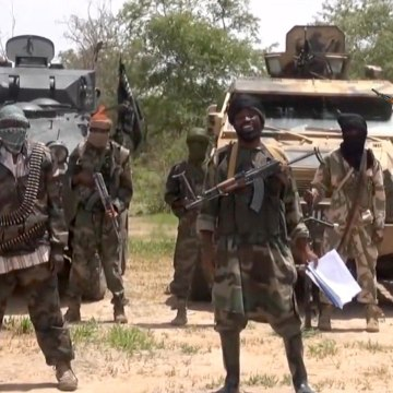Image:A screengrab taken on July 13, 2014 from a video released by the Nigerian Islamist extremist group Boko Haram and obtained by AFP shows the leader of the Nigerian Islamist extremist group Boko Haram, Abubakar Shekau (C), referring to the Bring Back