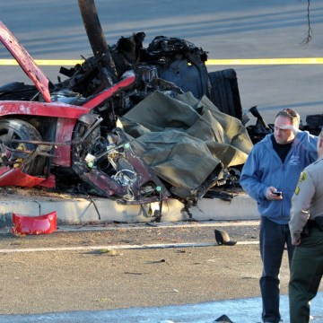Image: Sheriff deputies work near the wreckage of a Porsche