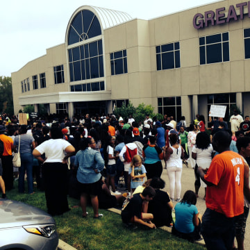 Image: Overflow crowd stands outside the Rally for Justice for Michael Brown in Ferguson
