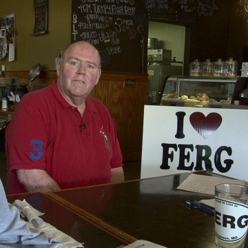 "Image: Brian Fletcher, who was mayor of Ferguson from 2005 to 2011, started a group called ""I Love Ferg."" He's collected thousands of dollars from local residents to buy lawn signs to ""counteract the incorrect information that's being given out nationally"