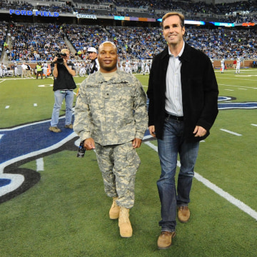 Image: Specialist Ira Brownridge joins Bob Woodruff for the coin toss at Ford Field, on Nov. 22, 2010.