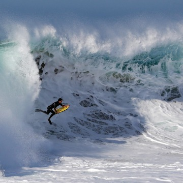 Image: A bogieboarder rides a wave at 'The Wedge' in Newport Beach, Calif.