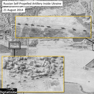 Image: Russian military units moving in a convoy formation with self-propelled artillery in the area of Krasnodon, Ukraine, well inside territory controlled by Russian separatists, in this satellite image captured on Aug. 21