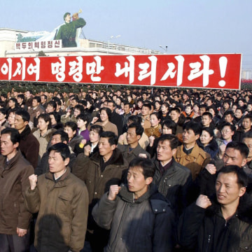 Image: KCNA picture shows North Korean citizens and soldiers attending a rally in Pyongyang