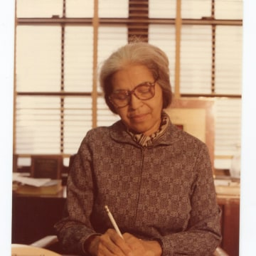 Image: A photo of Rosa Parks working at the Office of Congressman John Congers in 1985.